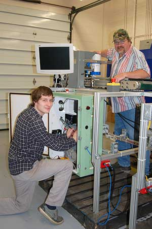 Student and instructor work on adjusting a piece of automation equipment
