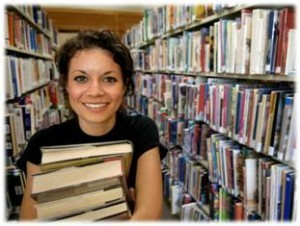 WPCC student in the library stacks