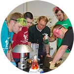 Photo of a group of high school students in a lab with WPCC biology instructor Michael Spath