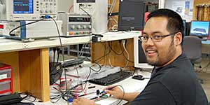 Photo of Electronics Student at Workstation