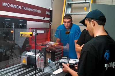 Students work at a mechanical training table