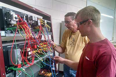 Students working at wiring rack