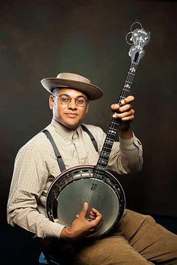 Photo of Dom Flemons with his banjo