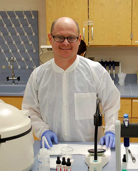 A male student works at a lab station at WPCC