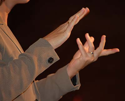 Closeup photo of two hands communicating via sign language