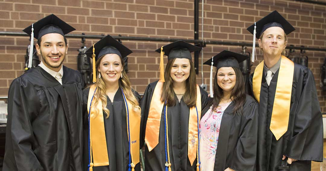 Smiling WPCC Graduates pose just before graduation exercises at the COMMA Auditorium in Morganton, NC
