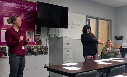 Breann Talent, Kay Smith, and Joy Boyd teaching ASL at Lowes Hardware in Hickory, NC