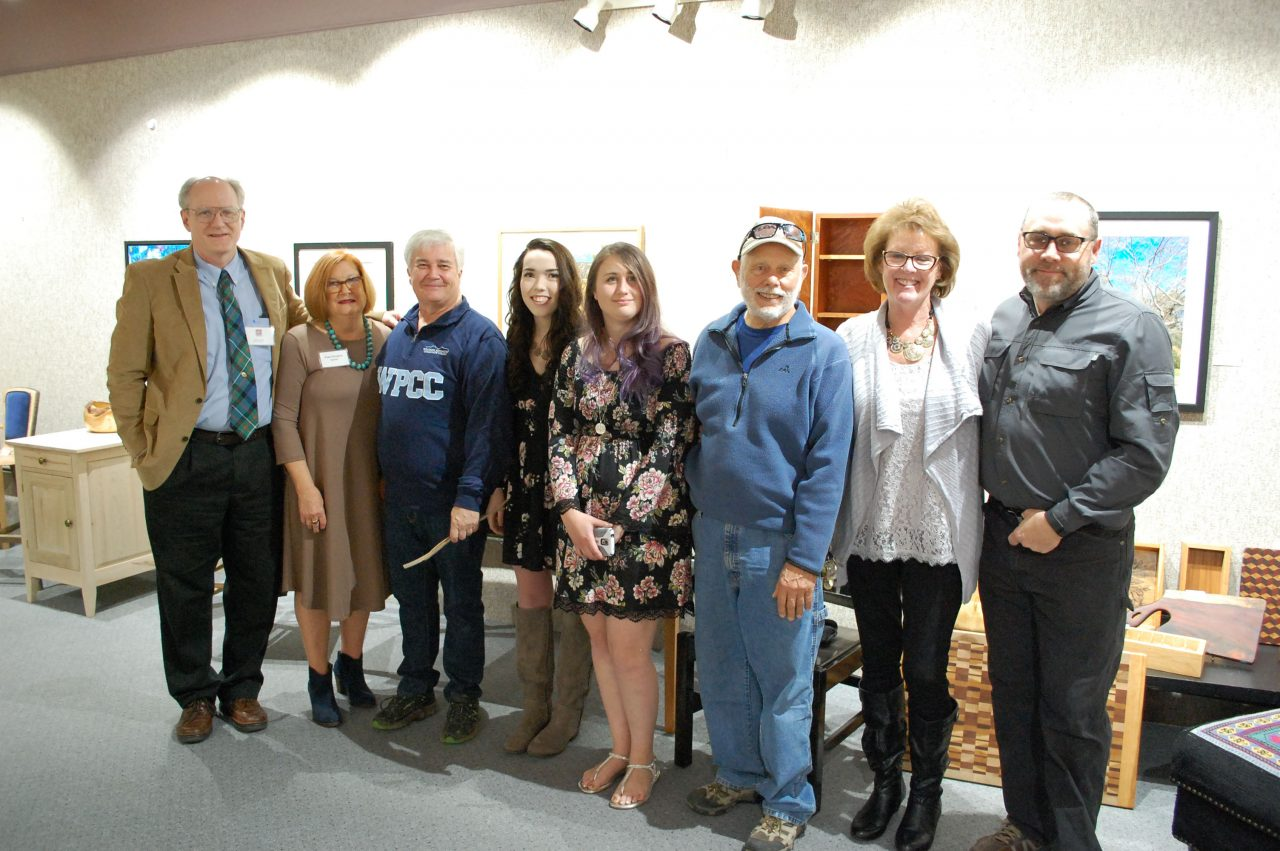 Photo of professional crafts wood students and instructor at the art gallery.