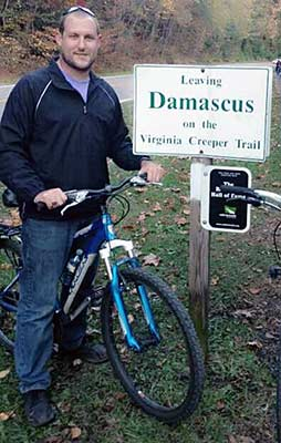 Photo of Kevin Winfree riding his bicycle on the Virginia Creeper Trail near Damascus, Virginia