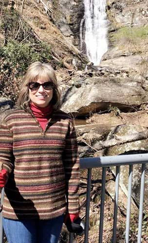 Photo of Doctor Gerri Adams with a waterfall in the background
