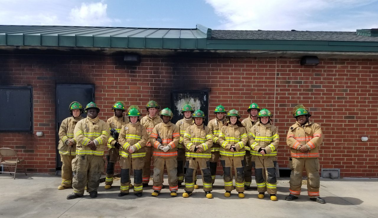 WPCC Firefighter Cadets pose in front of burn building