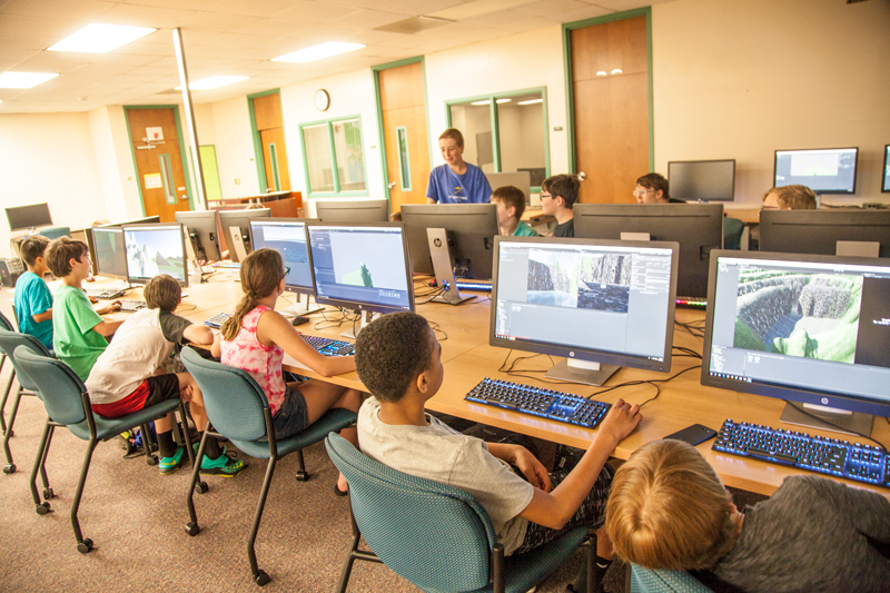 Children at computers during 2018 Sim and Game Camp
