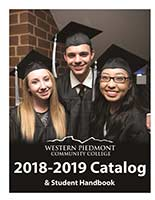 Photo of three WPCC graduates, one male and two female, posing at commencement ceremonies