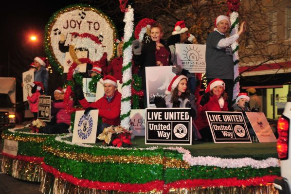 Men and women on a Christmas float made for a parade