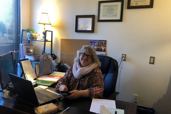 Woman at her desk at her place of employment in human services