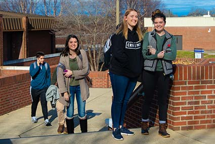 Several WPCC students walking between classes on the main campus