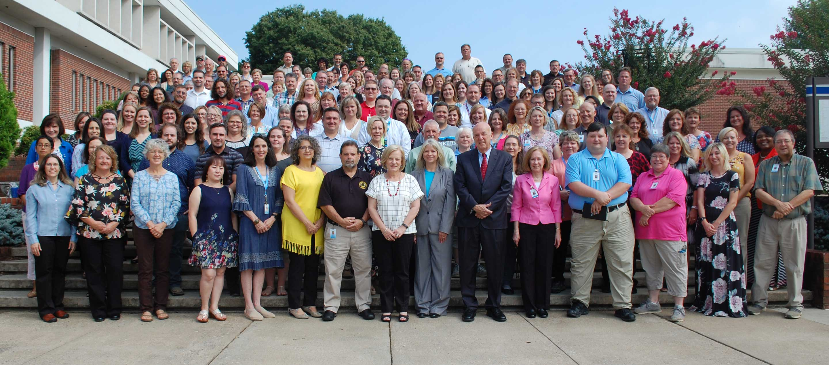 Photo of WPCC employees made August 12, 2019 on the steps between Moore, Patton, and Burnett Halls