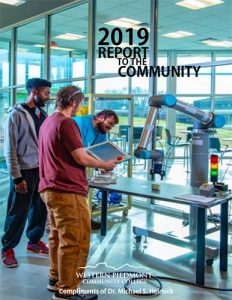 Photo of the front cover of the 2019 Report to the Community featuring several WPCC students working with a robotic hand, using it to pick up objects
