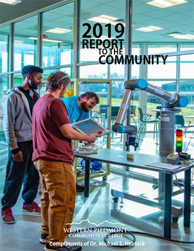 Photo of the front cov er of the 2019 Report to the Community featuring several WPCC students working with a robotic hand, using it to pick up objects