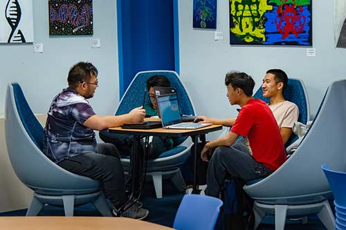 Four WPCC Students work together on computers in the library