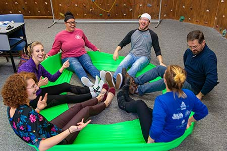 Photo of a Recreational Therapy Assistant class engaging in an activity with a stretch band at WPCC