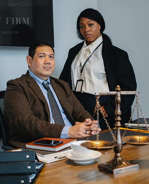 Photo of a Latino man and African American woman who work in a courtroom