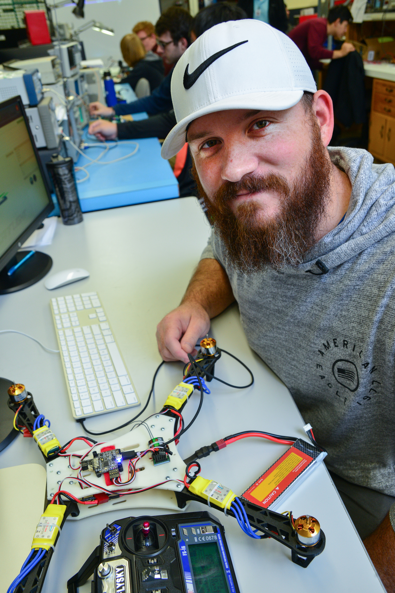 Electrical Engineering student works on a drone.